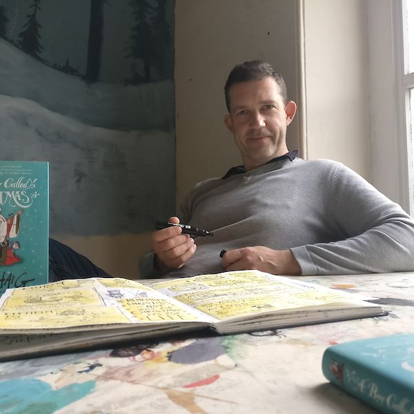 Chris Mould, the illustrator of A Boy Called Christmas, in his studio