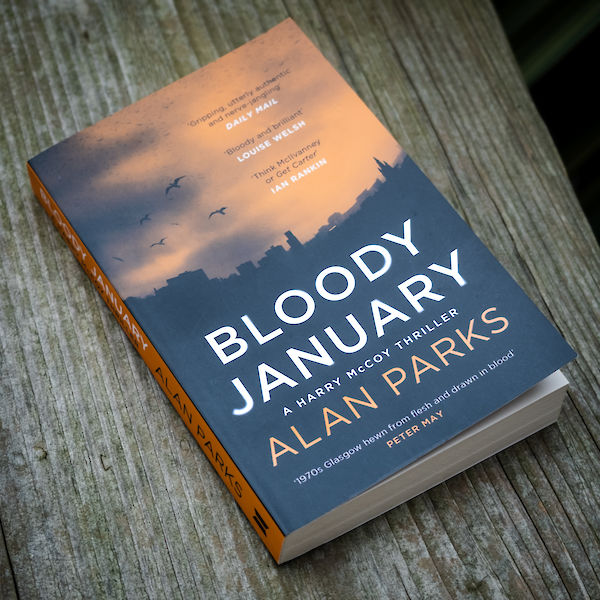 Bloody January by Alan Parks - paperback photograph