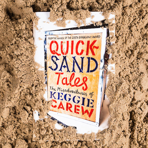 Quicksand Tales in sand photo